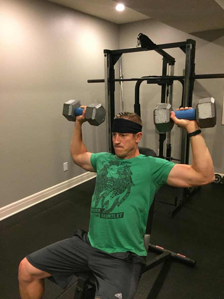 Conquer The Gauntlet Pro Team member Lucas Pfannenstiel uses Fat Gripz to turn even shoulder press into an exercise that improves grip strength.